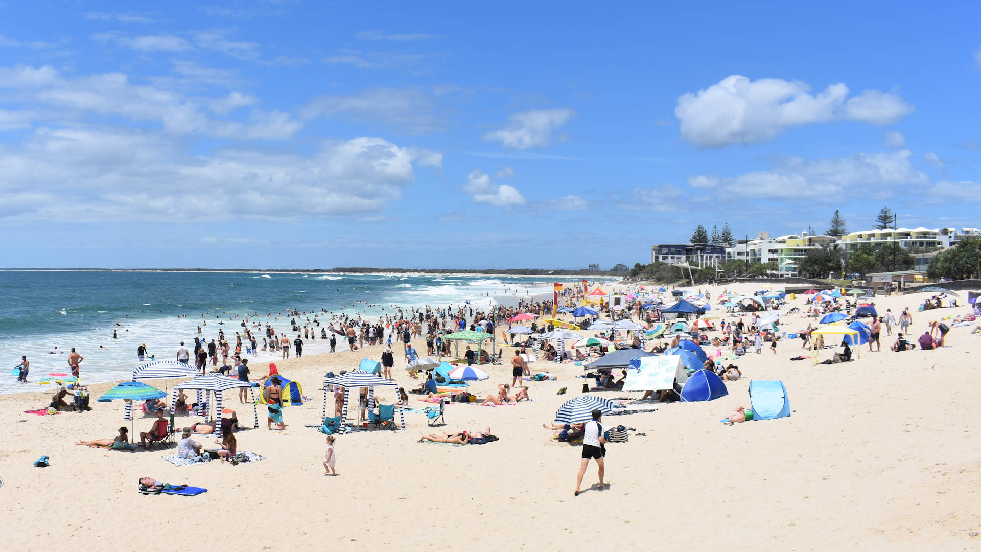 Kings Beach in Caloundra with a crowd of beach goers at the patrolled beach section