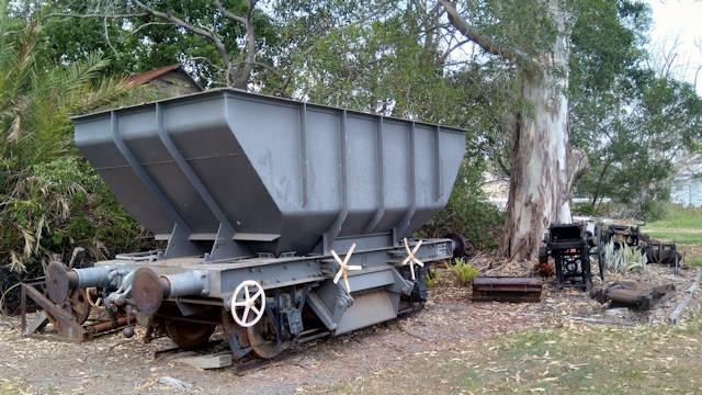 Old short railway coal car sitting off-track, taken at Howard Queensland