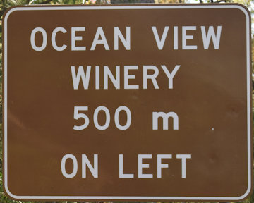 Brown sign for Ocean View Winery, 500m on left