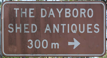 Brown sign for The Dayboro Shed Antiques, 300m